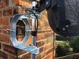 cradle bracket fixing and lashing on chimney for sky satellite dish.