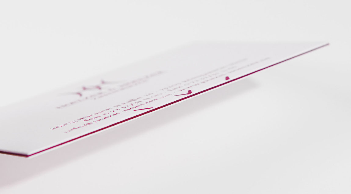 Unternehmensauftritt für die Zahnarztpraxis Hoelzer und Hoelzer Zahnärzte – Visitenkarte mit rotem Farbkern