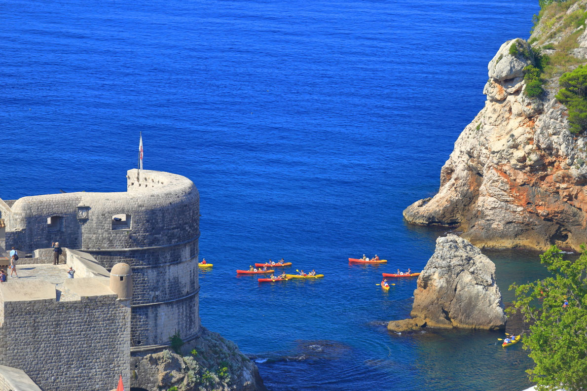 Tourists during kayak trip outside the walls of the old town of Dubrovnik, Croatia Copyright Inu