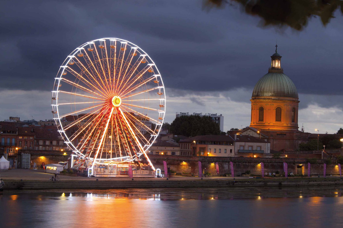 Most beautiful ferris wheels in Europe - Big wheel at night with lights and the dome, Toulouse, France Copyright Monica Mayayo V