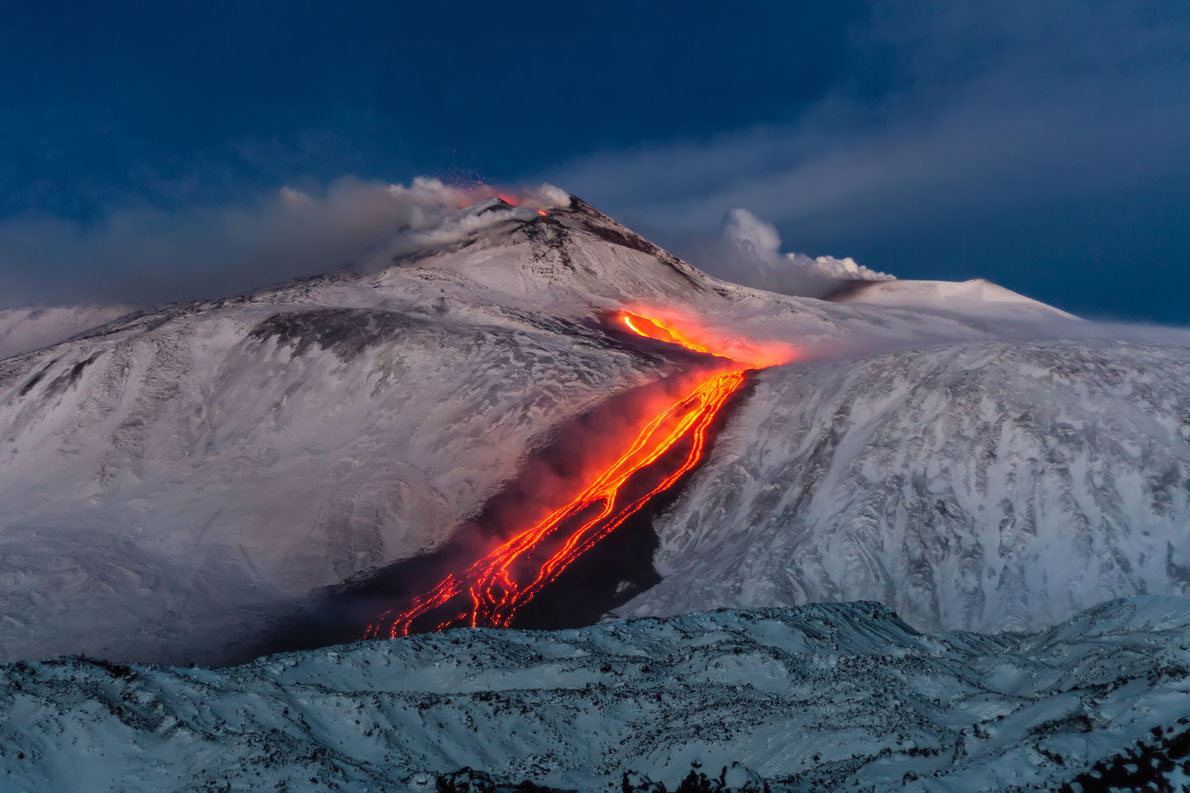 Most beautiful landscapes in Europe  - Volcano Etna Eruption - lava flow through the snow Copyright Wead