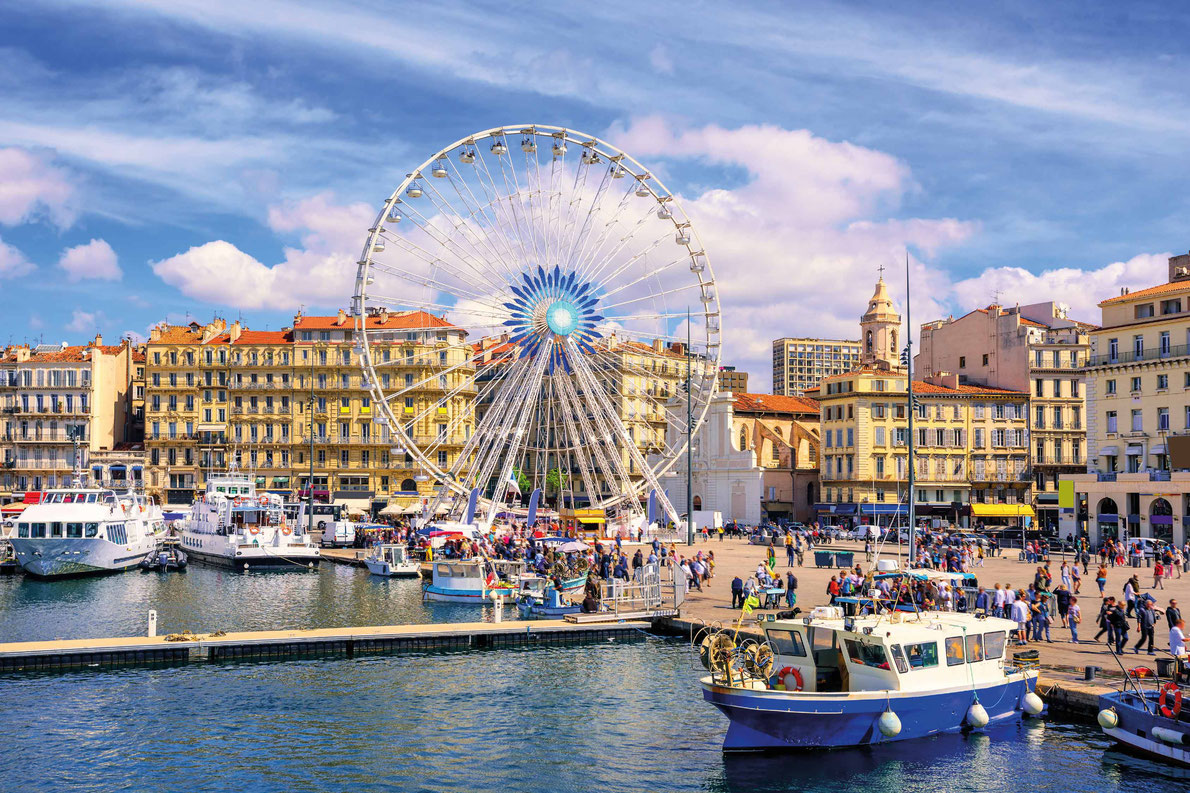 Most beautiful ferris wheels in Europe - The promenade of the Old Vieux Port in the city center of Marseilles, France Copyright Boris Stroujko