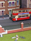Model of an M class tramcar in London Transport livery passing the park