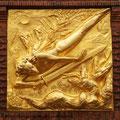 """""""Der Lichtbringer""""; vergoldetes Relief am Eingang der Böttcherstraße"""