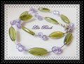 0997 - Grüne Oliven mit lila Silberfolie (EK)