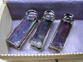 Portes serviettes de table plaquées argent de couleur mauves avec billes décoratives. Ensemble de 4. Viens avec la boîte 40$