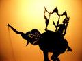 The Prince begins his journey to the land of the Princess/Le prince commence son voyage vers le pays de la princesse sur son  éléphant.
