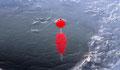 Un bouchon lors de la pêche au trou au lac de Guéry