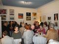"""Blick auf 2 Wände der Galerie Ehweiner mit ausgestellten Bildern  zum Thema """"Traumwelten"""""""