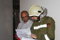Gruppenkommandant OV Ing. Martin Peer beim gemeldeten Brandmeldealarm, Station 3