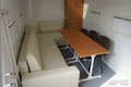 В салоне могут с относительным комфортом разместиться 9 человек - 5 на диване и 4 на стульях. Хотя, если потесниться...