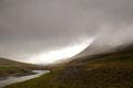 Blick in das Wolken verhangene Tal an der Straße nach Grenivik