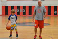 Coach Melesurgo guides a camper through a drill