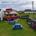 An english double decker bus on an Irish island, serving indonesion food
