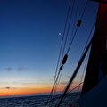 Welcoming sunrise after a menacing night, surfing down the steep waves and keeping the boat from heading diagonally the the waves