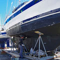 Painting the boat below the waterline with antifouling (against mussels and growth)