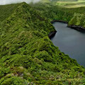 Green and black crater lakes