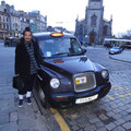 With an Edinburgh black cab