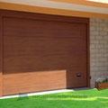 porta sezionale simil legno chiaro