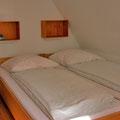 Amrum - Betten im Schlafzimmer der Ferienwohnung