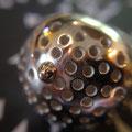 Hoogglans zilver met een bolletje goud