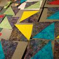 après avoir découpé des carrés, puis des triangles ...