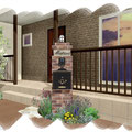 重厚なレンガの門柱とクラシックなポストでデザイン