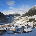 Das winterliche Madrano - hinten Airolo