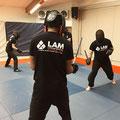 sparring combat baton rotin