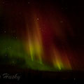 Aurora is caused by the collision of energetic charged particles with atoms in the high altitude atmosphere