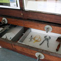 DOC Display Stand showcasing artifacts from the Historic Quarantine Station on Matiu/Somes Island.
