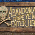 Abandon all hope.... Carved sign.
