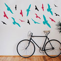 Small, Medium and Large set of 6 seagulls vinyl wall art on a living room wall.