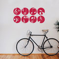 Red vinyl wall art sticker set of eight music circles on a living room wall.