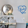 Mr & Mrs Baker are in love, surrounded by a love heart vinyl wall art from www.wallartcompany.co.uk