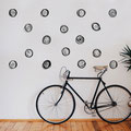 Swirly Flower heads in black vinyl decorating a wall in a living room.