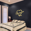 Mr & Mrs Thompson are in love, surrounded by a love heart vinyl wall art from www.wallartcompany.co.uk