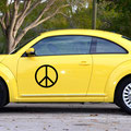 Black Skinny Peace sign decal on the side of a car