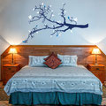 Spring Branch. Blue vinyl tree branch with white and light blue leaves vinyl wall art decal.
