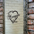 Mrs & Mrs Morgan are in love, surrounded by a love heart vinyl wall art from www.wallartcompany.co.uk