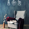 White set of three decal Angels in a hand drawn style on a living room wall.