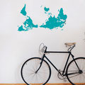 World map decal with tear drop shapes marking places that have been visited or to go!