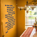Modern lords pray vinyl wall art on a living room wall