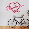 Mr & Mrs Henderson are in love, surrounded by a love heart vinyl wall art from www.wallartcompany.co.uk