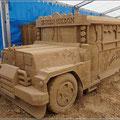Bus aus Sand