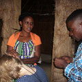One guest tries a Tanzanian hairstyle at Eco Camp