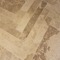 Valley travertine cut in a herringbone pattern.