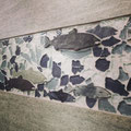 Diamond Dimensions grout with Slate fish tile and blue Glass mosaics between grey porcelain that looks like sandstone