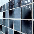 Diamond Dimensions grout with blue and white ripple glass creates a cool watery effect.