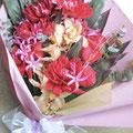 還暦のお祝い:お好きなランと真紅のバラを入れた赤をベースにした花束にしました。